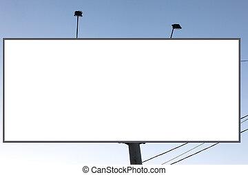 Empty roadside billboards against blue sky