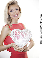 Beautiful lady posing with heart.