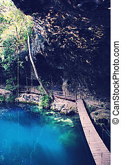 Sinkhole in Mexico - Sinkhole (cenote) in Mexico with wooden...