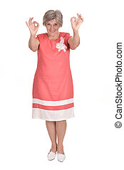 Woman shows ok sign - Portrait of elderly woman in a red...
