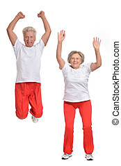 Elderly couple exercising - Active elderly couple exercising...
