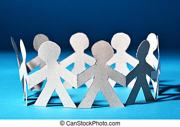 Team of paper people in chain