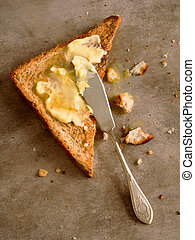 toasted butter - close up of a slice of toast bread with...