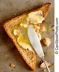 toasted bread - close up of a slice of toast with melted...