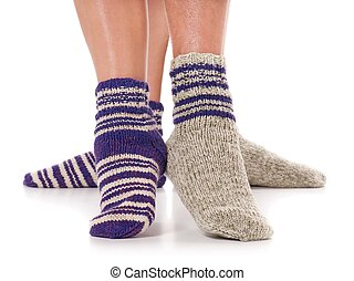 Knitted socks - Pair of man and woman in the knitted socks...