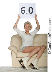 Skater sitting on a sofa isolated on white