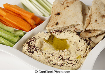 Hummus dip and crudites - A dip tray with hummus, bread,...