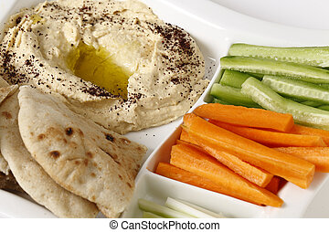 Crudites and hummus dip - A dip tray with hummus, bread,...