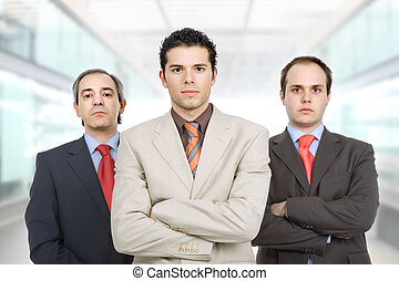 business men - three business men at the office