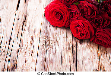 Red roses on wood - Detail of red roses on wood, low depth...