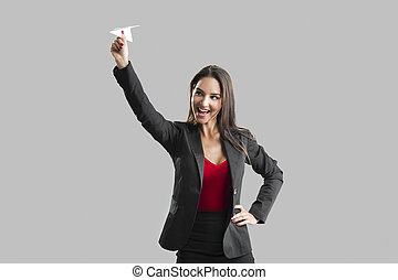 Woman throwing a paper plane - Beautiful business woman...