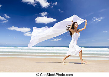 Jumping with a white scarf - Beautiful girl in the beach...