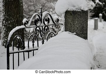 snow covered wrought iron gate