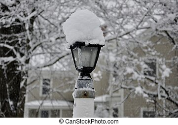 snow covered street lamp