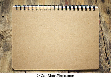 notepad isolated on woode background