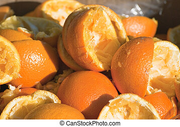 Discarded Squeezed Orange Halves - Closeup of squeezed out...