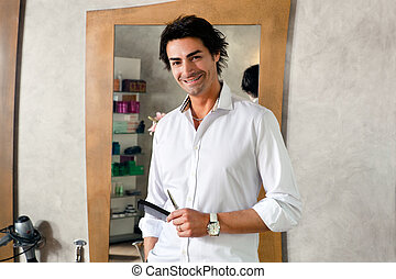 hair salon - portrait of mid adult hairstylist looking at...