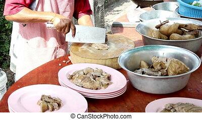 preparing boil stewed duck for customer at Thai restaurant