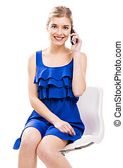 Beautiful woman talking by phone - Beautiful woman sitting...