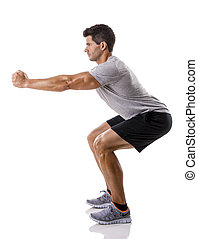 Man doing exercises - Athletic man running doing squats,...