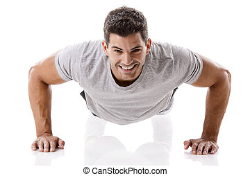 Handsome young man making pushups - Man making pushups in...