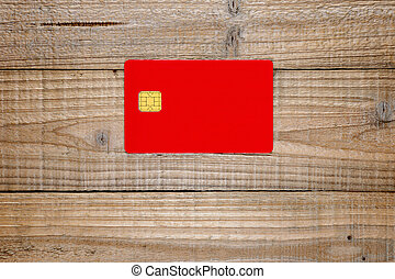 Credit card with chip on wooden background