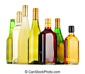 Bottles of assorted alcoholic beverages isolated on white...