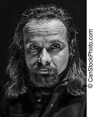 portrait of the long-haired bearded man - black and white...