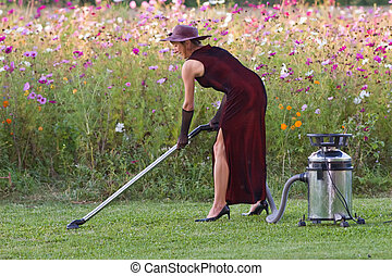 woman nature keeper - woman cleaning natural green carpet in...