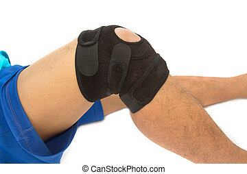 man legs with one knee in a protective knee brace