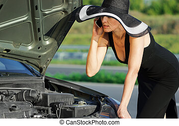 Woman with broken car - Woman with telephone near the broken...