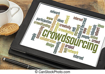 crowdsourcing word cloud on a digital tablet with a cup of...
