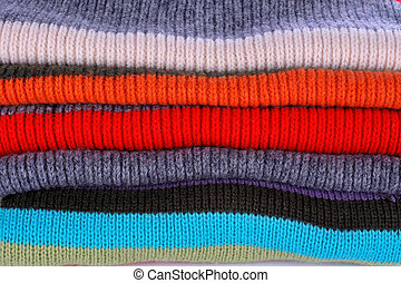 Several colors pullovers stack - Background of several...