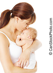 Mother kissing newborn baby holding in hand, white...