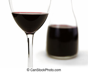 Glass of red wine isolated on white with carafe in...