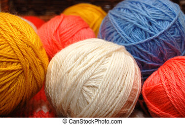 Close up on multi-coloured balls of a wool