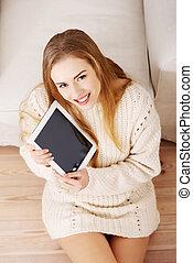 Beautiful caucasain woman holding tablet. - Beautiful...