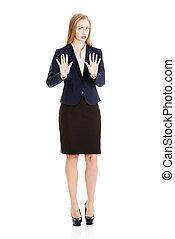 Beautiful caucasian business woman is showing refusing,...