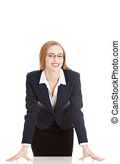 Beautiful business woman bending over table. Isolated on...