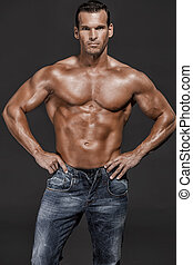 Hot man - Muscle man posing in studio, isolated over a white...