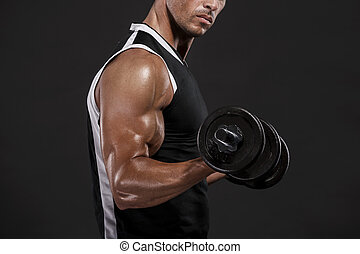 Lifting weights - Muscle man in studio lifting weights,...