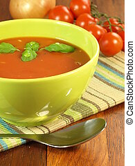 Tomato soup - Delicious tomato soup with basil in bowl