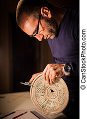 Ancient crock - an archeologist examining some ancient...