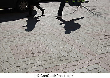 catch me if you can - shadows of running man and walking...