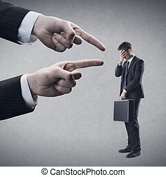 Pointing fingers - Fingers pointing at young employee.