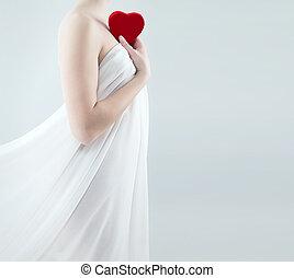 gorgeous woman holding red heart - gorgeous woman in a white...
