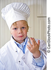 Dirty fingers - A boy, dressed in a chef\'s uniform, showing...