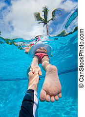 Follow me - Father holding his little daughter feet while...