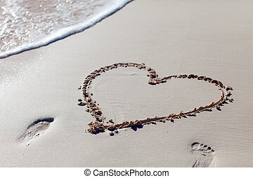 Heart drawn on beach