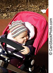 Baby in pram - Photo of 11 months old baby sitting in pram